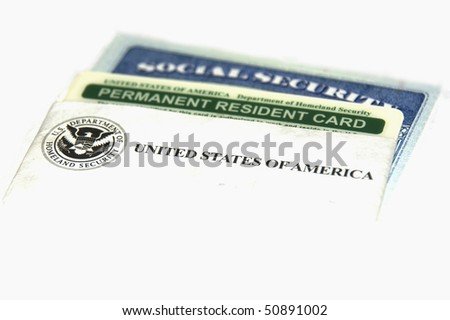 Permanent resident and social security cards - stock photo
