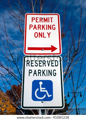 Permit Parking Only sign and Reserved Parking sign with wheelchair handicap symbol - stock photo