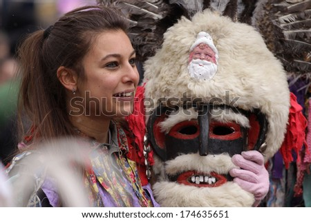 PERNIK, BULGARIA - JAN 25, 2014: Traditional Kukeri costume are seen at the the International Festival of the Masquerade Games Surva in Pernik, Bulgaria. Photo taken on: January 25th, 2014