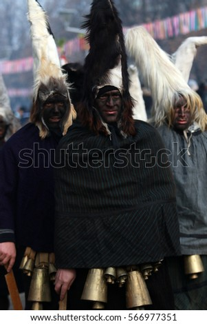PERNIK, BULGARIA - JANUARY 29, 2017 - Masquerade festival Surva in Pernik, Bulgaria. People with mask called Kukeri dance and perform to scare the evil spirits.