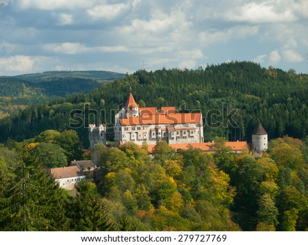 Pernstejn gothic castle in the autumnal forest, Czech Republic - stock photo