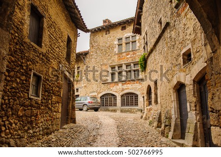 PEROUGES, FRANCE - OCT 11, 2016: Narrow street of Perouges, France, a medieval walled town, a popular touristic attraction.