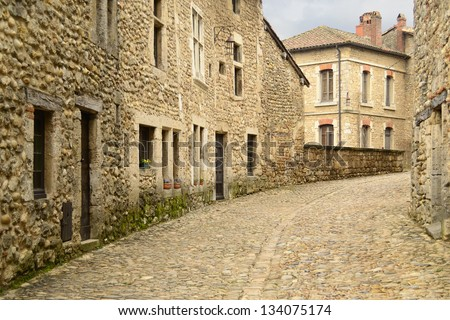 Perouges, medieval village in Lyon, Rhone Alps, France. Panoramic view of old houses made with stone and cobbled street