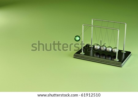 Perpetual motion. Pendulum on green background. 3d - stock photo