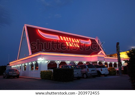 PERPIGNAN, FRANCE - JUNE 7: Buffalo Grill Restaurant illuminated at dusk.  Buffalo Grill is a chain of steakhouses based in France. June 7th 2014 in Perpignan, France
