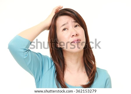 perplexed Japanese woman   - stock photo