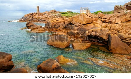 PERROS-GUIREC, FRANCE - AUGUST 14: Lighthouse at Pink Granite Coast. Pink rock formations can only be found in two other places in the world, Corsica, China on August 14, 2012 in Perros-Guirec,France - stock photo