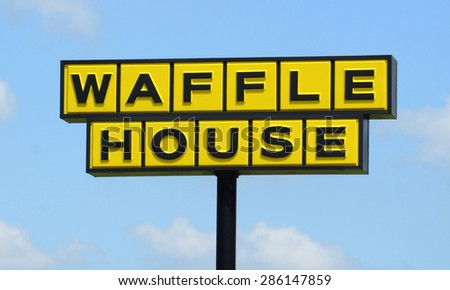 PERRYSBURG, OH - JUNE 2:  Waffle House, whose Perrysburg location sign is shown on June 2, 2015, has more than 2,100 locations in 25 states - stock photo