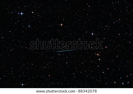 Perseid meteor crossing the starry sky - stock photo
