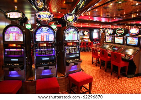 PERSIAN GULF - APRIL 14: Slot machines in play room, April 14, 2010 in Persian. Slot machines - most popular gambling. - stock photo