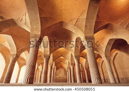 Persian mosque Vakil with carved columns in huge historical hall, built at 1773 in Shiraz, Iran
