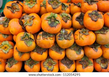 Persimmon fruit background - stock photo
