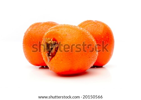 persimmon fruits against white background