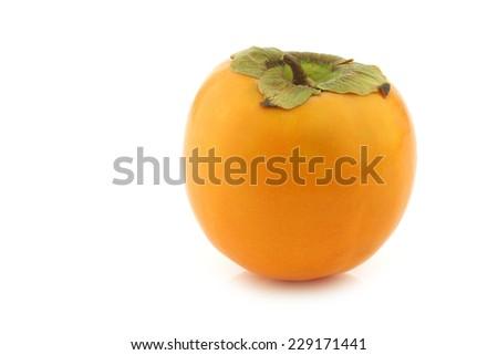 persimmon (kaki) fruit on a white background - stock photo