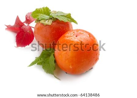 persimmon on white - stock photo
