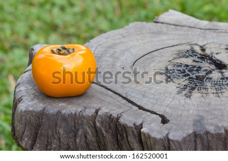 persimmons one on wooden table