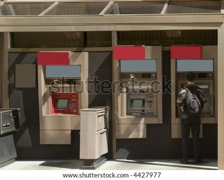 Person accessing Automatic Teller Machine - stock photo