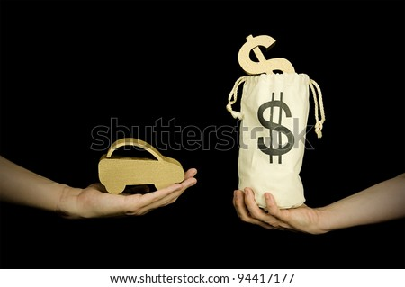 person buying a car with a bag full of dollars, black background - stock photo