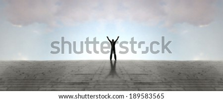 Person celebrates at top of stairway - stock photo