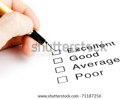 person checking excellent on a survey - stock photo