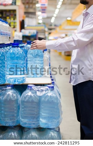 person choosing or packing bottles of delicious water - stock photo