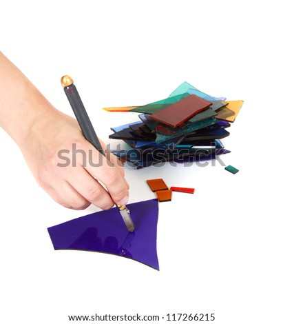 person cutting glass - stock photo