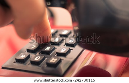 person digits numbers on the home telephone. concept about communication - stock photo