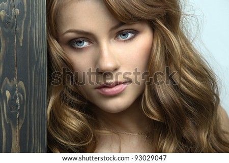 Person feminine model with sensual lips and expressive eyes close-up