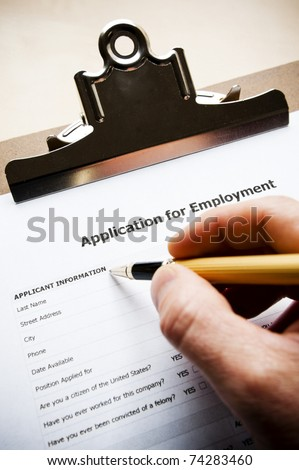 person filling out a job application - stock photo