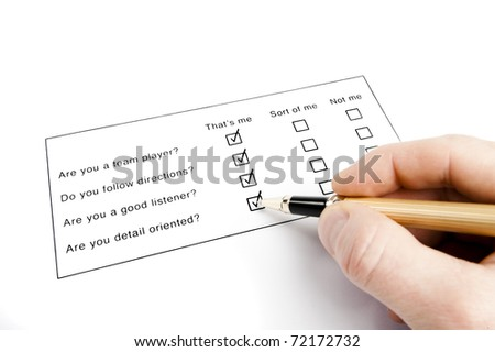 person filling out a questionnaire - stock photo