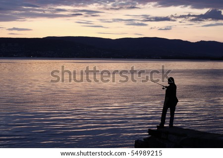Person fishing just after sunset
