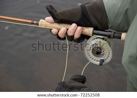 Person fly fishing - stock photo