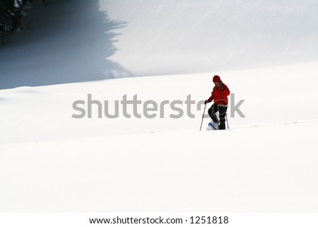 Person going down the ski slopes. Face unrecognizable.
