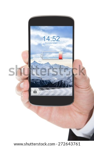 Person Hand Holding Mobile Phone With Low Battery Over White Background