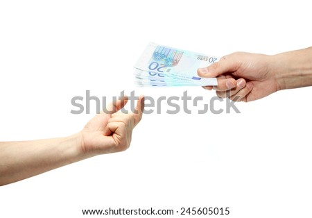 Person handing money to another person. - stock photo