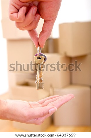 Person handing over the keys of a new house - moving concepts - stock photo