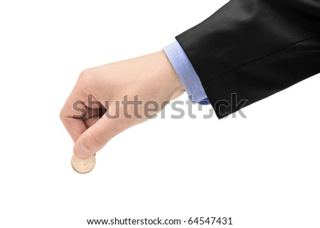 Person holding a coin isolated against white background - stock photo