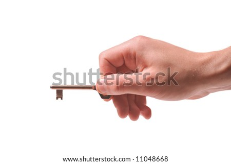 Person holding a door key isolated on white - stock photo