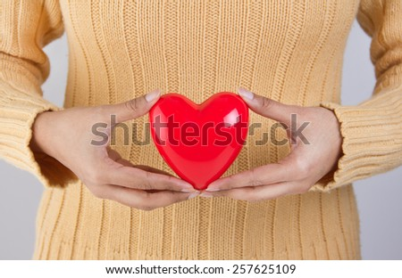 Person holding a heart - healthy lifestyle concept - stock photo