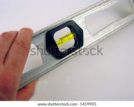 Person holding a level tool - stock photo