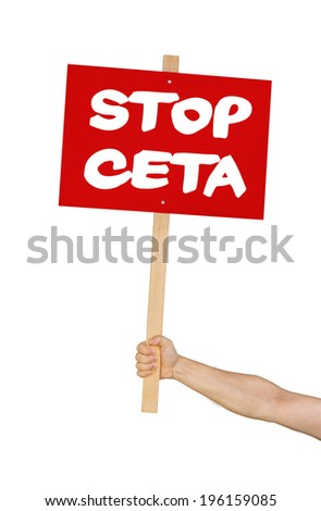 Person holding a sign saying Stop CETA - stock photo