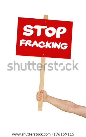 Person holding a sign saying Stop Fracking - stock photo