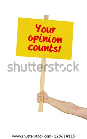 Person holding a sign saying Your opinion counts - stock photo