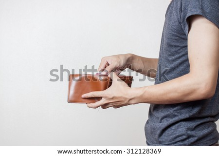 Person holding an empty wallet - stock photo