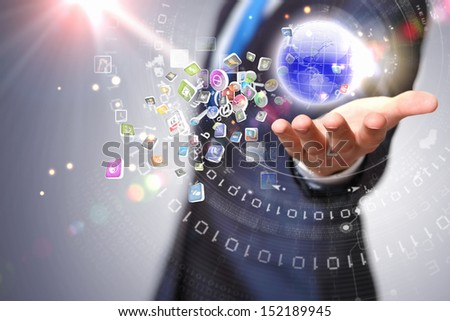 Person holding illustration of globe in hand. Media technologies - stock photo
