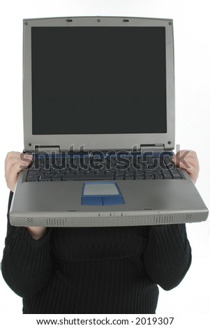Person holding laptop in front of face.
