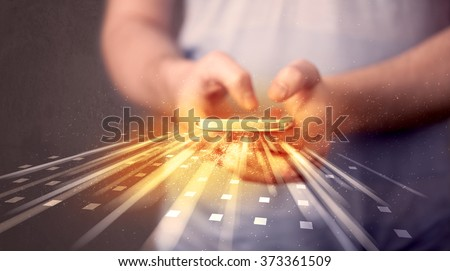 Person holding smarthphone with technology light applications comming out - stock photo