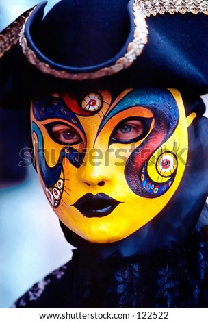 Person in a Venetian Carnival mask - stock photo