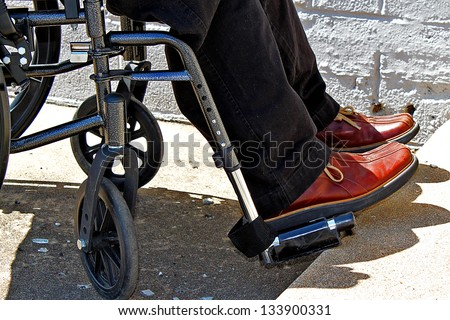 Person in a wheelchair - stock photo