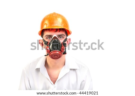 person in protective mask and old hard hat
